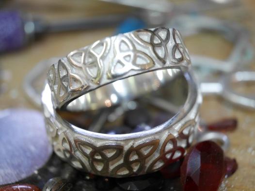 Trinity knot rings.